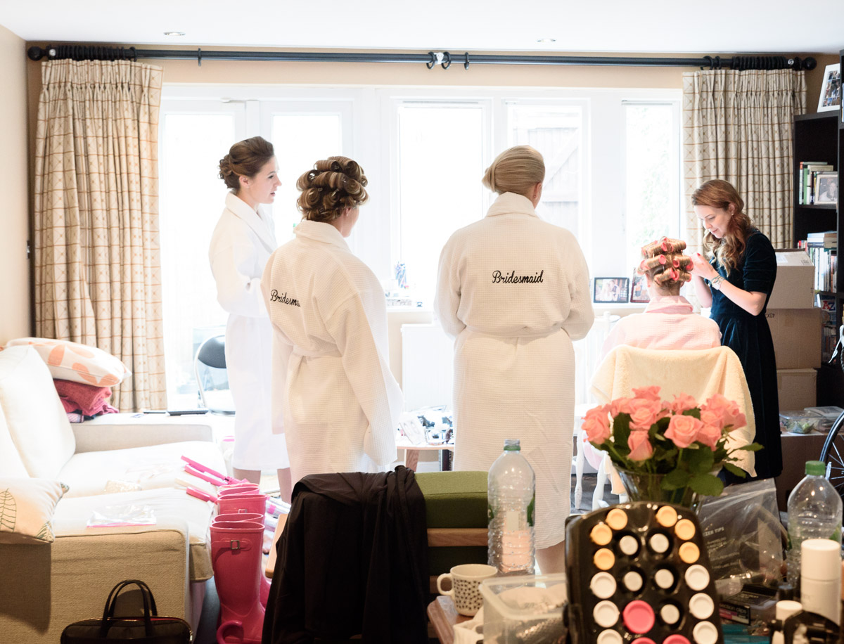 bridesmaids watch bride-to-be during bridal preparation
