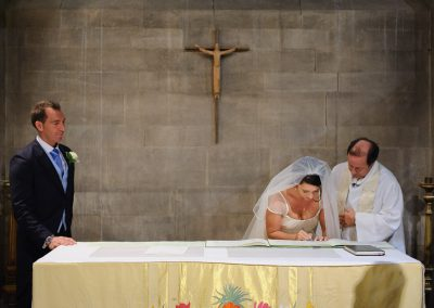 bride-signs-register-in-church