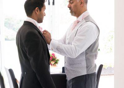 father-adjusts-grooms-cravat