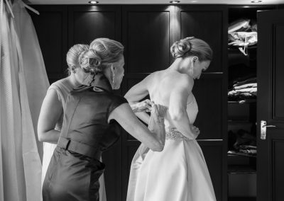 mother-helps-bride-with-wedding-dress
