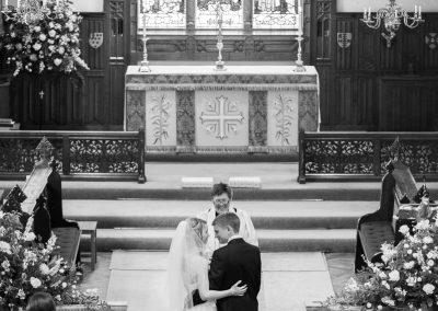 newlyweds-hug-in-church