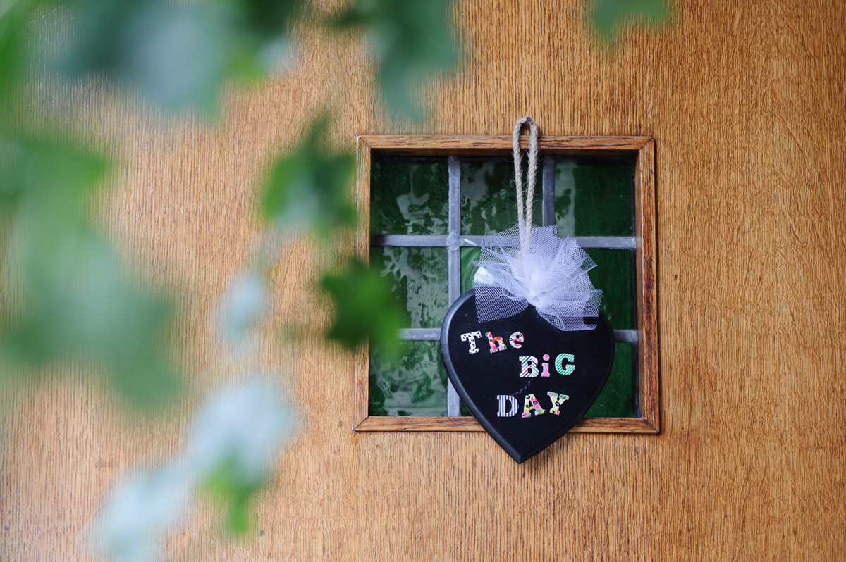 a wedding details sign hanging on a door