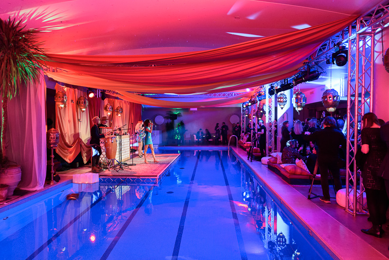 musicians performing by indoor swimming pool