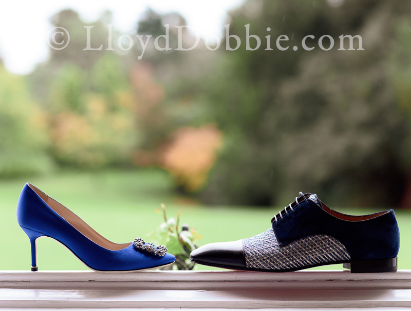 two pairs of wedding shoes on a windowsill at nonsuch mansion