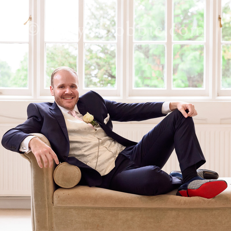 portrait of bridegroom wearing louboutin shoes