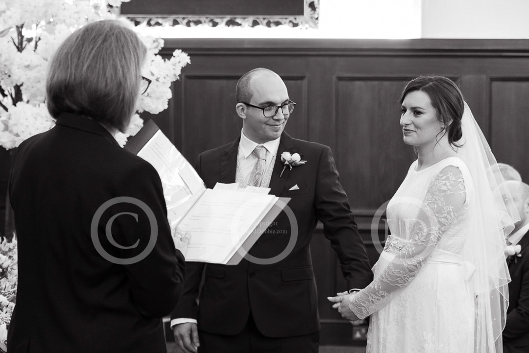 bride and groom in ceremony at fulham palace wedding