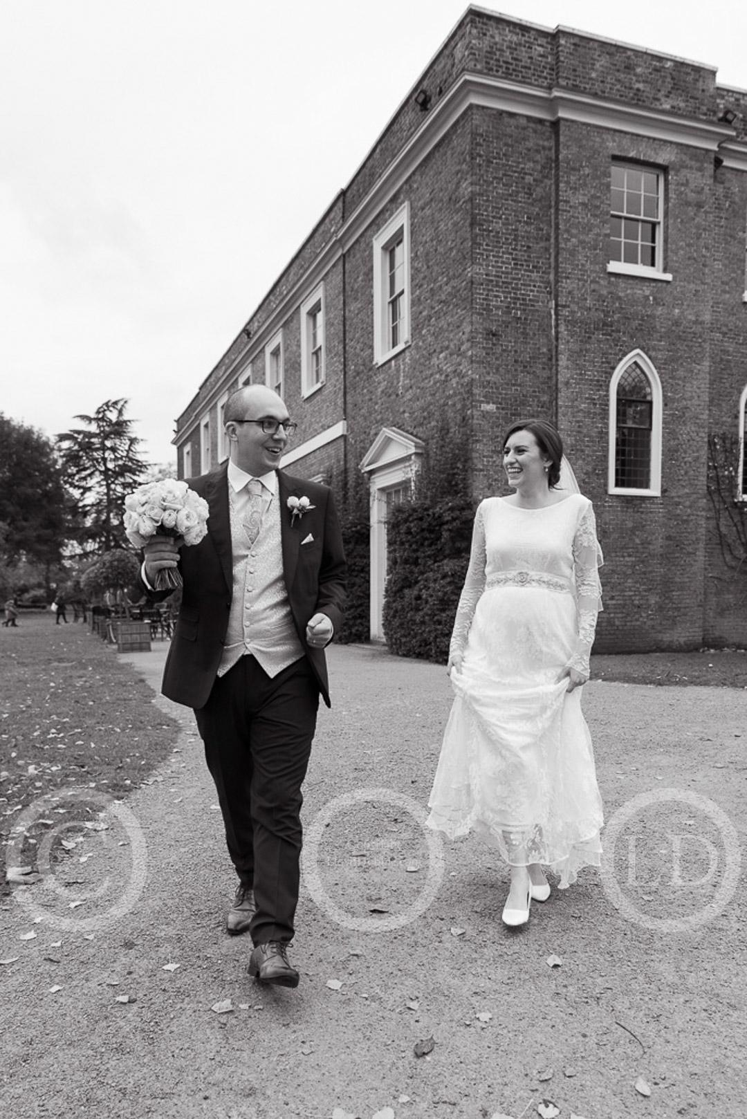 newlyweds walk away at fulham palace wedding