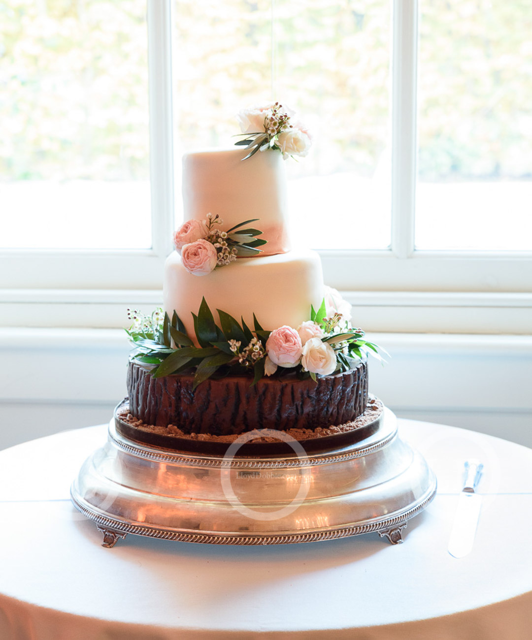 close up of wedding cake in window
