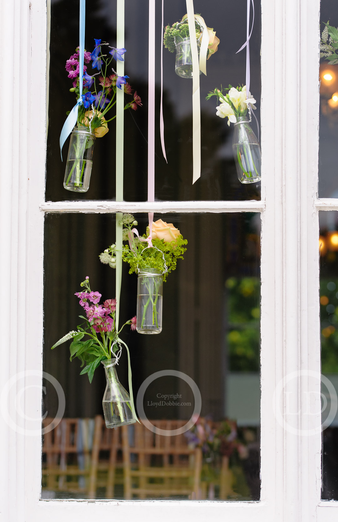 wedding flowers displayed in window at nonsuch mansion