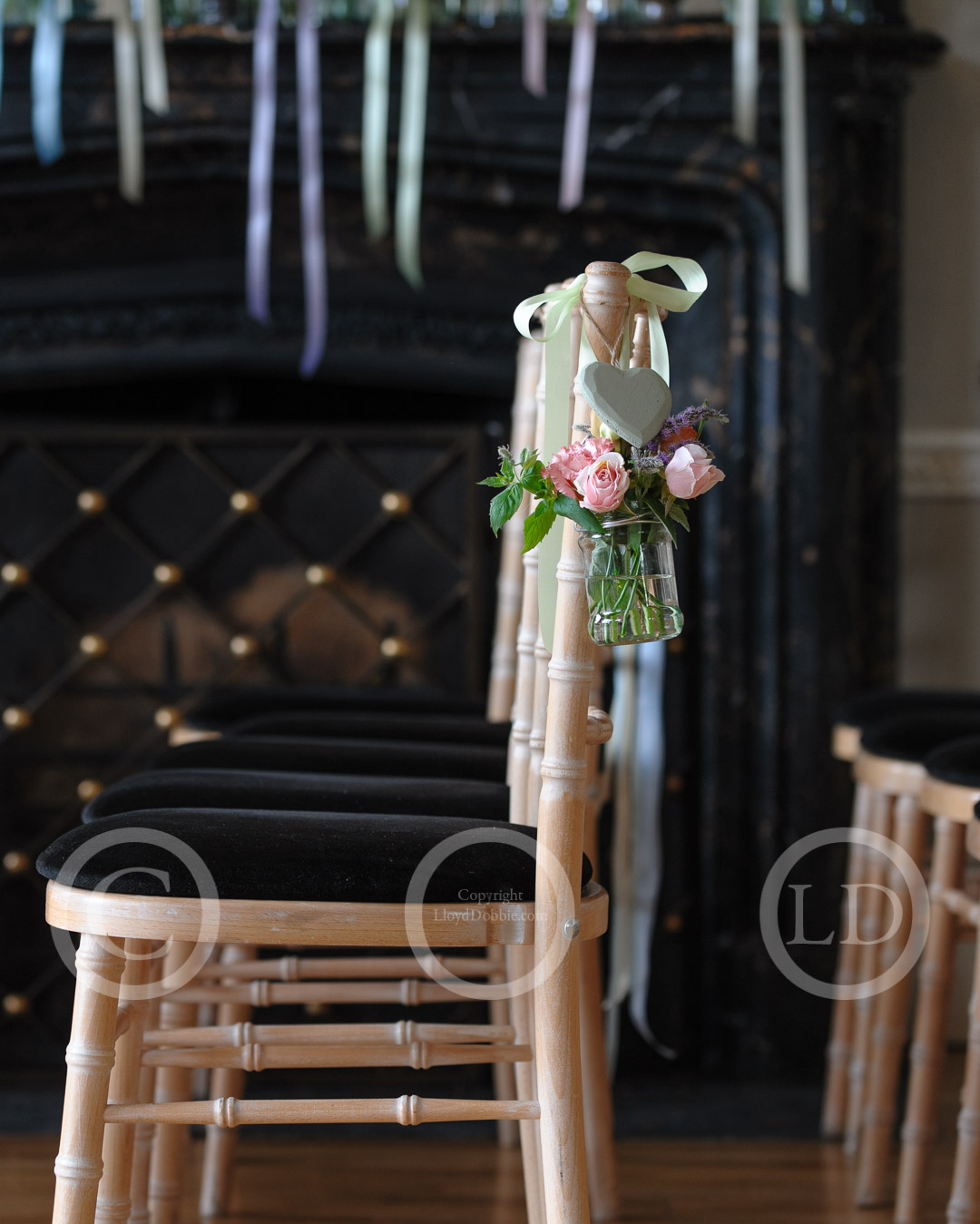 wedding flowers hanging on chair at nonsuch mansion