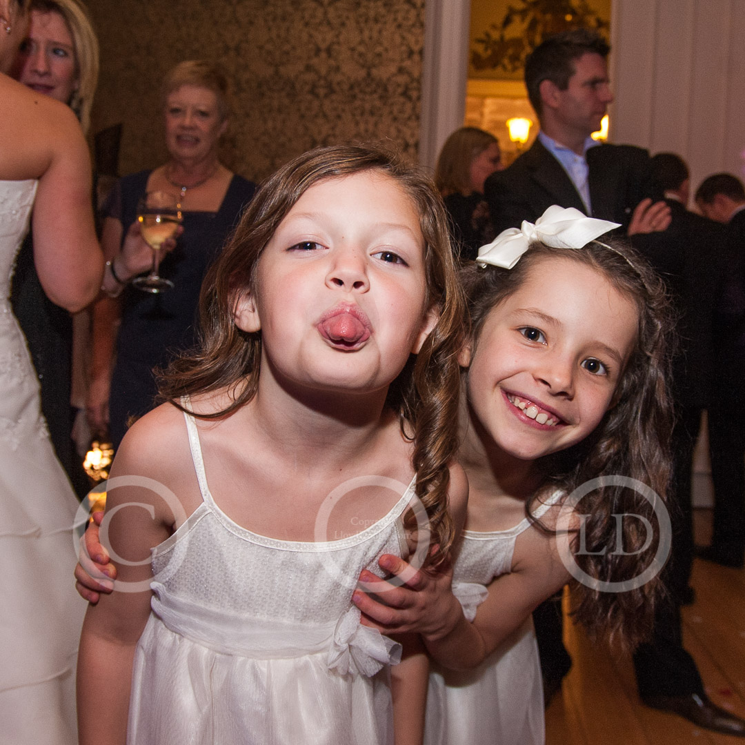 two flower girls smile at camera