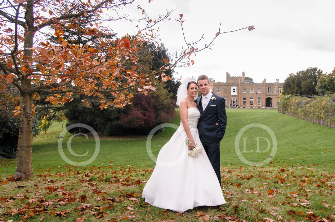 newlyweds pose in front of nonsuch mansion in autumn