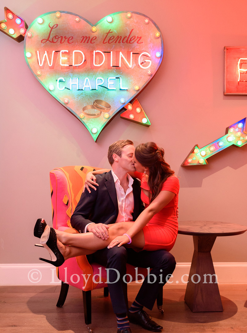 kissing couple in front of neon sign at ham yard hotel
